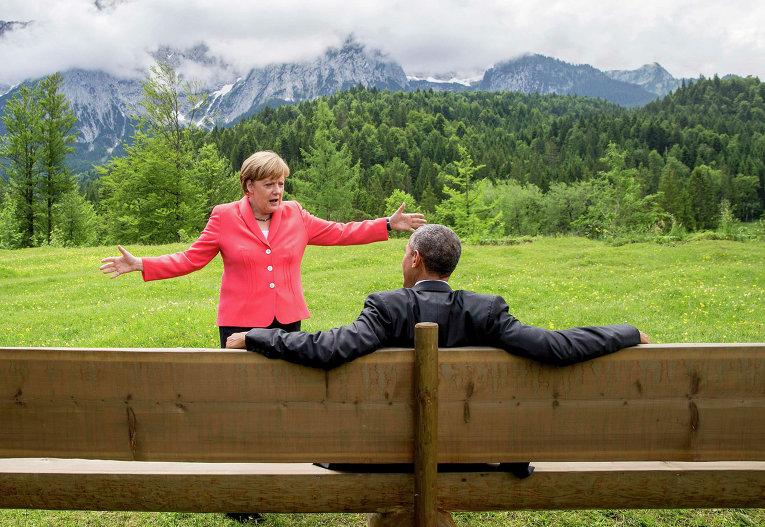 СМИ единодушно иллюстрировали саммит G7 фото Меркель и Обамы на фоне гор