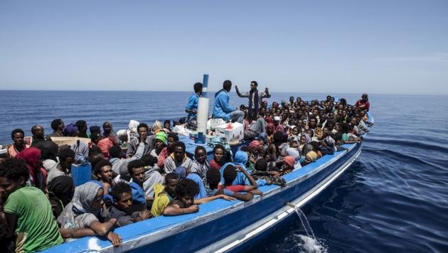 Беженцы и Африки.