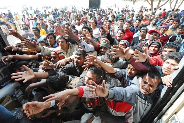 Рекордный поток беженцев прибывающих в страны ЕС