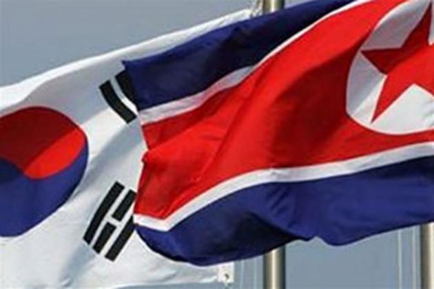 Флаги Южной  Кореи и КНДР.
