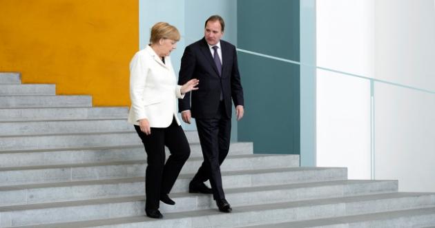 Стефан Лёвен и Ангела Меркель.
