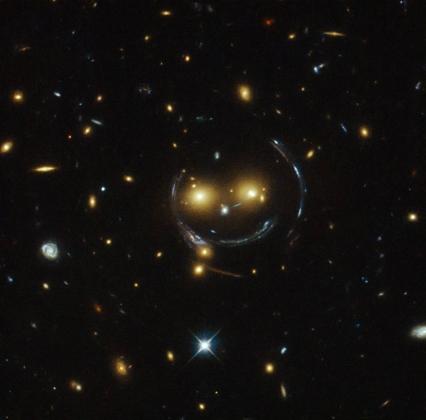 Улыбающиеся скопления галактик SDSS J1038+4849