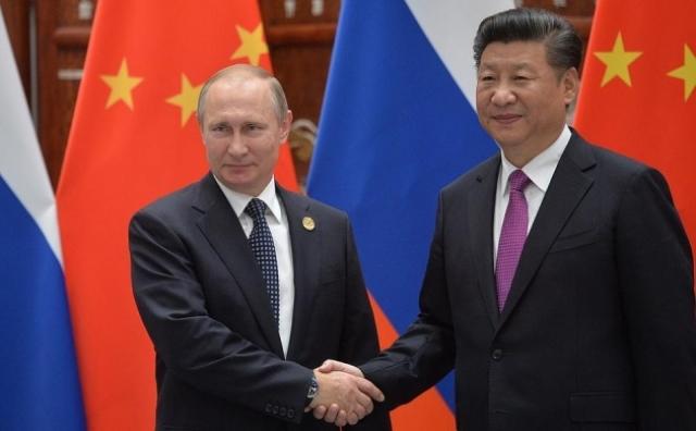 Председатель Си Цзиньпин и Владимир Путин