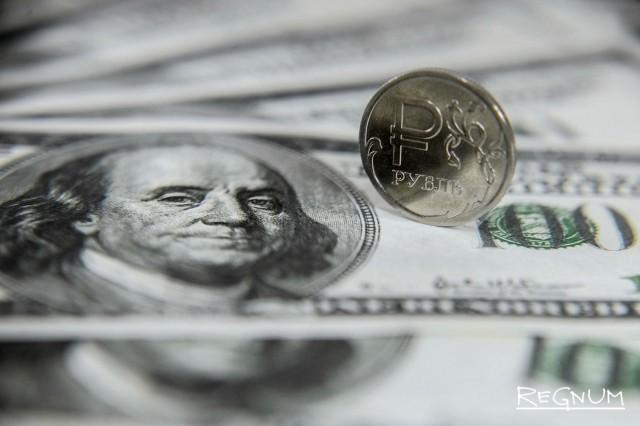 Рубль укрепился к доллару почти на 1%